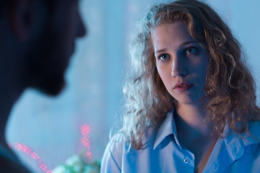 Worried woman talking with boyfriend - blue picture